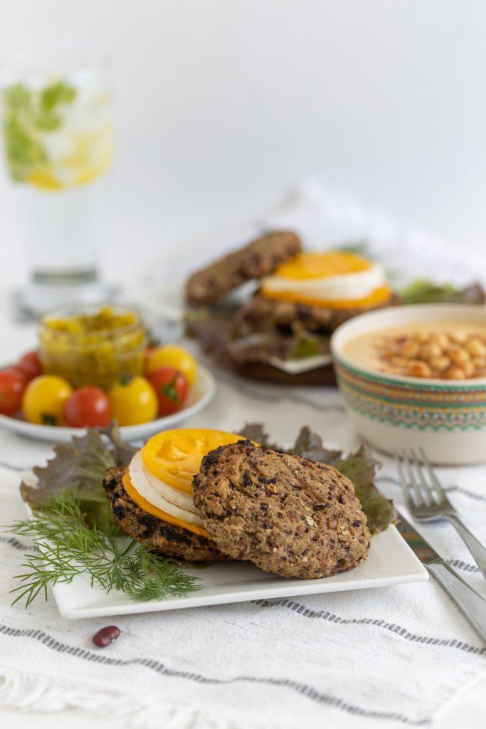 Vegan Seitan burgers served as patties with homemade hummus and veggies